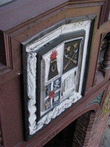 The house crest before repair